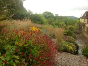Barn House Garden - Autumn grasses terrace persicaria